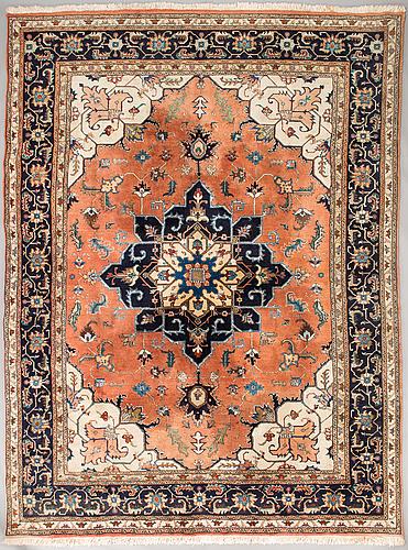 An oriental/eastern europe carpet, 324 x 242 cm.