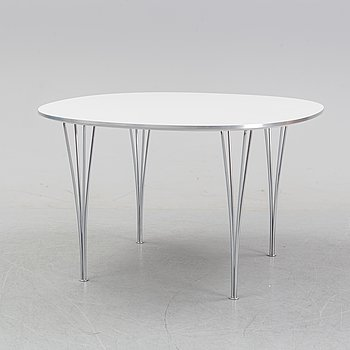 A 'Supercircular' table by Bruno Mathsson & Piet Hein for Fritz Hansen, dated 1985.