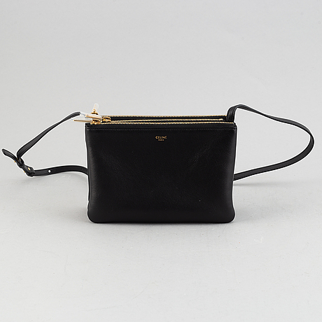 Céline, a black leather 'trio bag'.