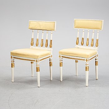 A pair of late gustavian chairs, around the year 1800.