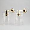 Hans-agne jakobsson, a set of brass wall lights, model v305.