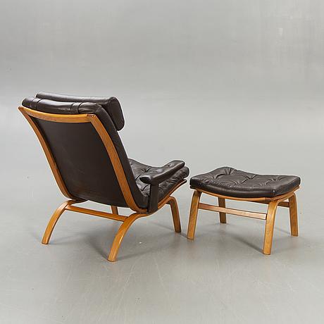 A götene easy chair and stool 1970s.