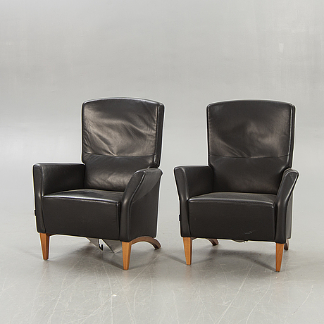 A pair of söderbergs leather easy chairs later part of the 20th century.