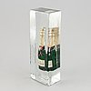 A glas sculpture with a champagne bottle by leif ahrle.