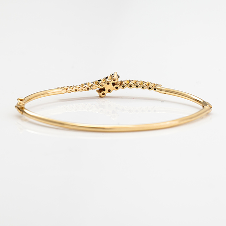 A 14k gold bracelet with sapphires and diamonds ca. 0.44 ct in total.