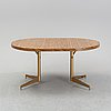 A dining table with four chairs, walter of wabash, table dated 1960.