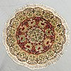 A semiantique tabriz carpet diameter 95 cm.