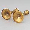 A circa 1900 empire style brass candlesticks.