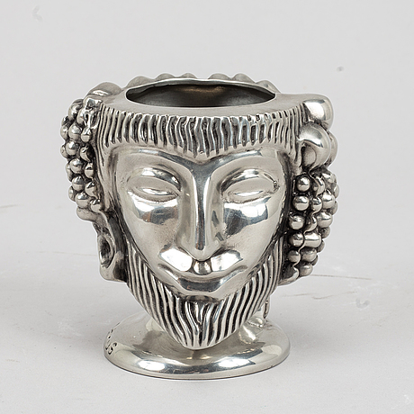 "Anna petrus, a ""janushuvud"" pewter vase, for firma svenskt tenn, stockholm 2020."