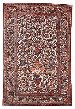 A rug, semi-antique, Kashan, part silk, ca 204,5 x 133-137 cm.