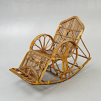 A bamboo and rattan rocking chair later part of the 20t century.