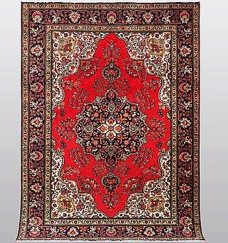 A carpet, Tabriz 272 x 200 cm.