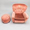 A mid-20th century armchair and ottoman.