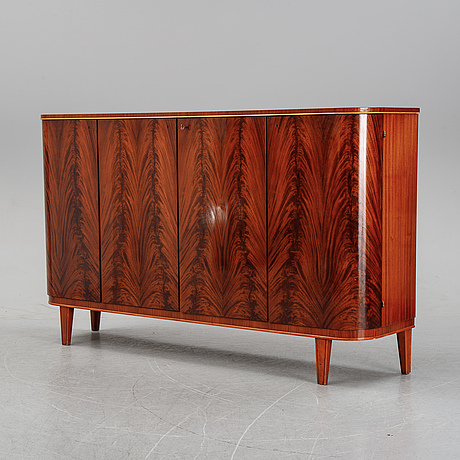 A mahogany sideboard from the 1940s.