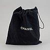 "A chanel ""flap bag""."