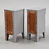A pair of painted bedside tables stands. first half of the 20th century.