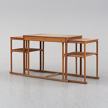 A walnut 'Släden' nesting table by Carl Malmsten.