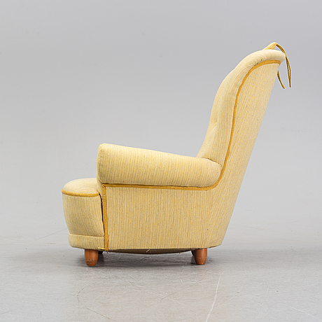 A 'jättepaddan' easy chair by carl malmsten, second half of the 20th century.