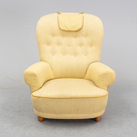 A 'jättepaddan' easy chair by carl malmsten, second half of the 20th century.