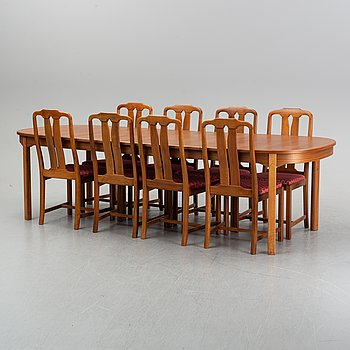 An 'Ambassadör' dining table with eight chairs by Carl Malmsten, second half of the 20th Century.