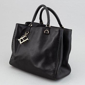 Caroline Herrera, a leather handbag.