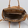 Prada, a leather handbag.