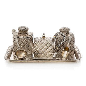 255. A  Russian parcel-gilt silver trompe l'oeil tea service, makers mark of Vasiliy Ivanov, St. Petersburg 1895.