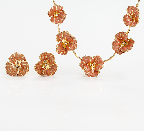 Christian dior, a nacklace and earrings made of gold coloured metal, rhinestones and enamel.