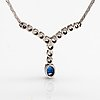An 18k white gold necklace with a sapphire and diamonds ca. 0.41 ct in total. finnish import marks.