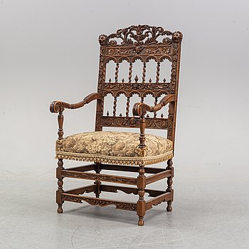 A carved Baroque style armchair, late 19th Century.