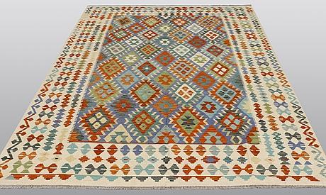 A carpet, kilim, ca 294 x 205 cm.