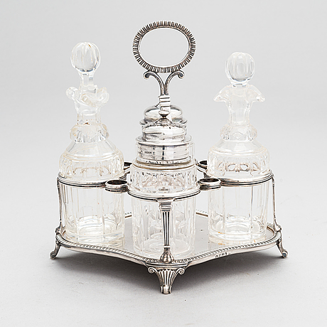Glass and sterling silver cruet stand, maker's marks of samuel hennell and robert hennell iii, london 1811 and 1879.