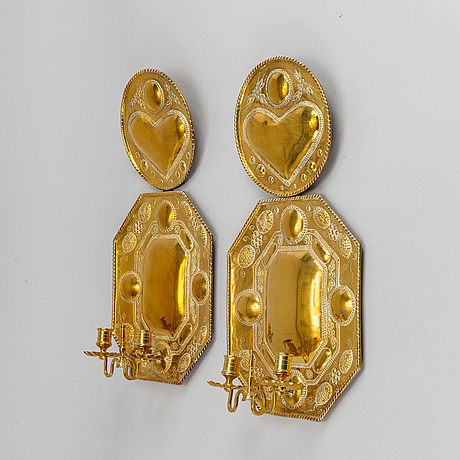 A pair of brass baroque style wall sconces, aroudn the year 1900.