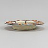 A deep ceramic plate by birger kaipiainen for arabia.