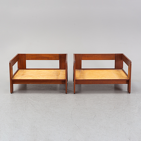 A pair of teak and leather easy chairs, second half of the 20th century.