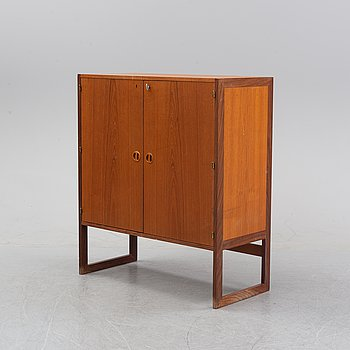 A teak cupboard from the middle of the 20th century.