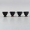 A set of four cast iron garden urns, 20th century.
