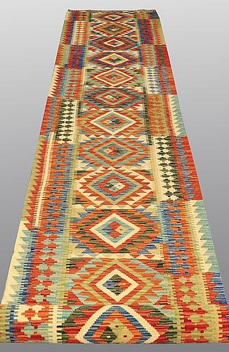A runner, kilim, ca 618 x 83 cm.