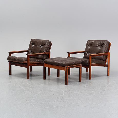 Illum wikkelsö, a pair of 'capella' easy chairs and one stool. eilersen, denmark. designed 1959.