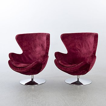 A pair of late 20th century velvet easy chairs.