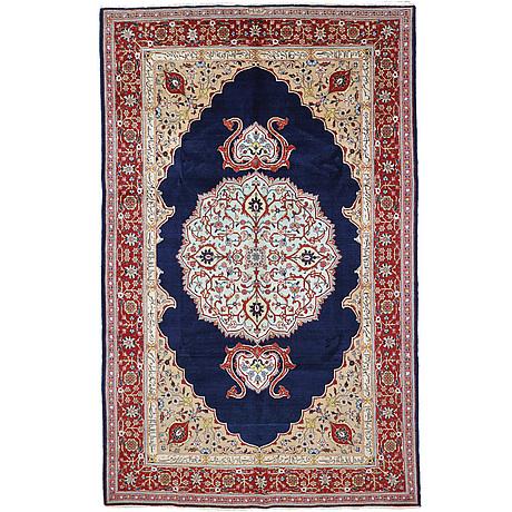 A carpet, tabriz signed nematzadeh, ca 291 x 176 cm.