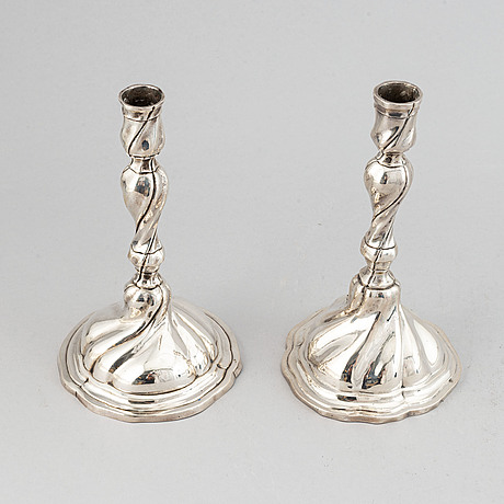 A matched pair of swedish silver rococo candlesticks,  18th century.