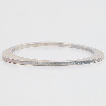 Silver bangle, by Georg Jensen.