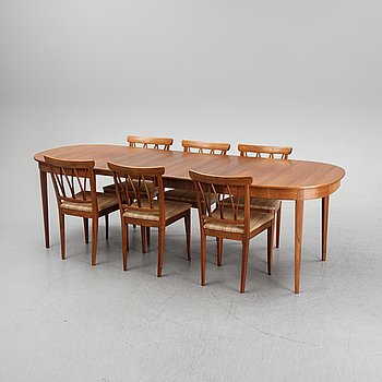 A dining table with six chairs by Carl Malmsten for Åfors.
