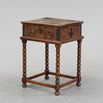 A carved wooden box, dated 1784.