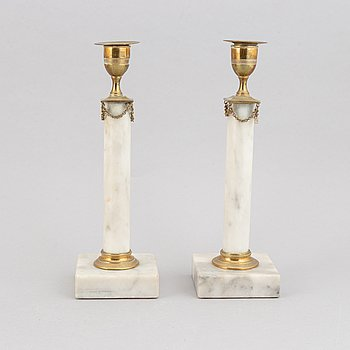 A pair of marble and brass candlesticks, Gustavian style, 20th century.
