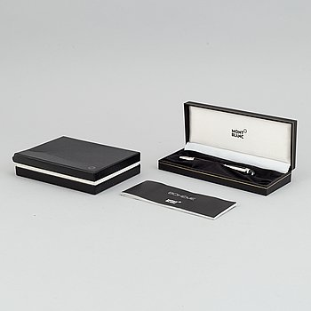 MOntblanc, a ball point pen and leather passport holder.