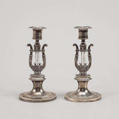 A pair of swedish empire silver candlesticks, mark of adolf zethelius, stockholm 1824.