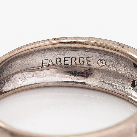 Fabergé, an 18k white gold ring with enamel and diamonds ca. 0.04 ct in total. victor mayer.
