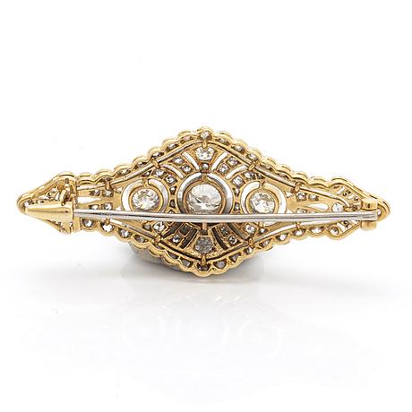Brosch 18k vitguld och guld gammalslipade diamanter och rosenstenar ca 1,5 ct, ca 4,5 x 2 cm.